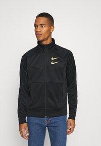 Nike Sportswear - Training jacket - black/gold foil - 0