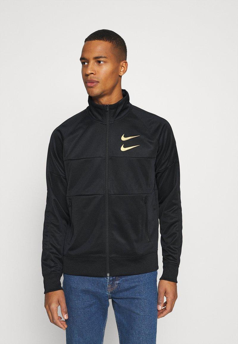 Nike Sportswear - Training jacket - black/gold foil