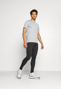 4F - Men's training leggings - Collants - black - 1