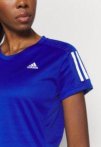 adidas Performance - OWN THE RUN TEE - T-shirts med print - blue - 5