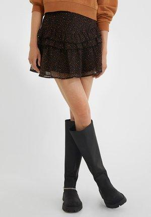 NEEA VOLANTS  - A-line skirt - black/old whiskey irregular dots