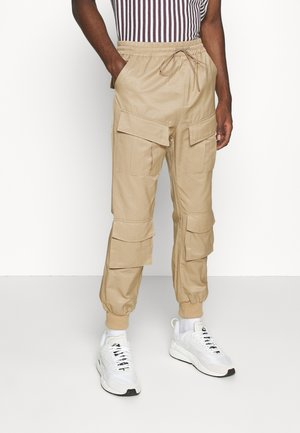 UTILITY PANTS - Cargo trousers - beige