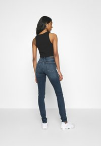 Weekday - BODY HIGH - Jeansy Skinny Fit - mid blue - 2