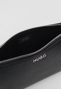 HUGO - VICTORIA MINI BAG - Umhängetasche - black - 4