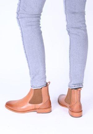 SUVI - Classic ankle boots - cognac