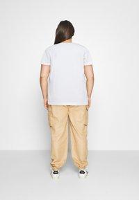 Tommy Hilfiger Curve - TEE REGULAR WOMEN UNITE - Print T-shirt - optic white - 2
