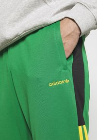 adidas Originals - CLASSICS  - Tracksuit bottoms - green/black - 3