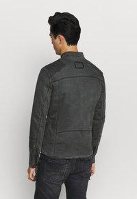 Tigha - TOMAS - Denim jacket - vinatge black - 2