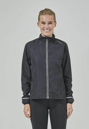 SHELA - Training jacket -  black