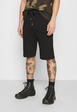 BASIC FOIL PRINT - Pantalones deportivos - black/yellow gold