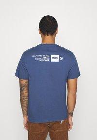 Levi's® - TEE UNISEX - Print T-shirt - blue indigo - 2