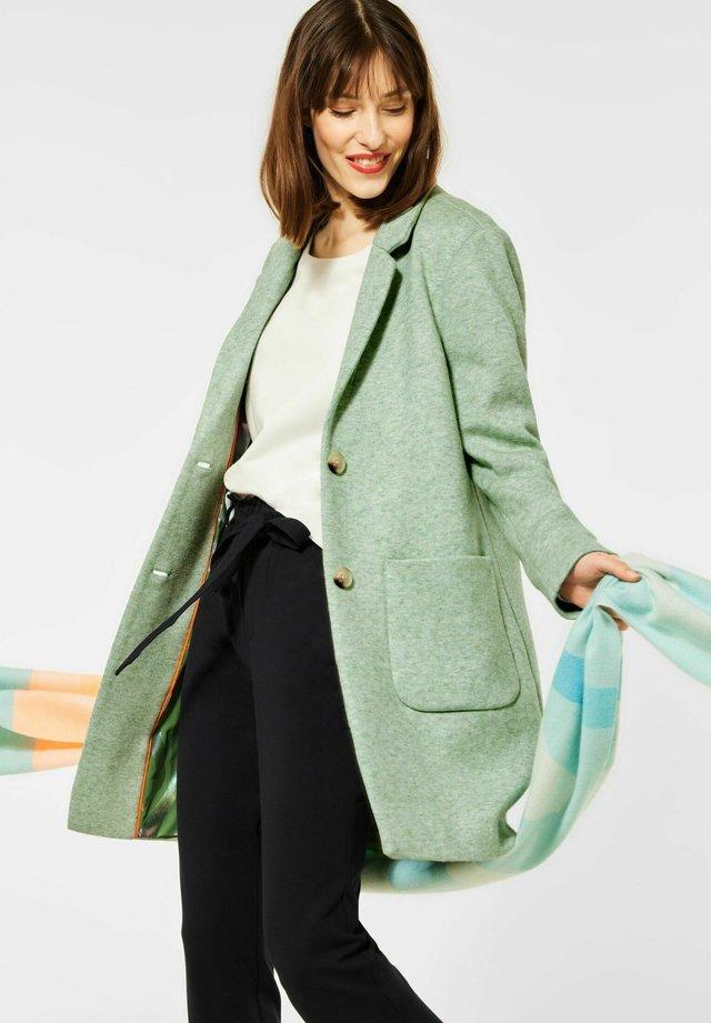 Halflange jas - grün