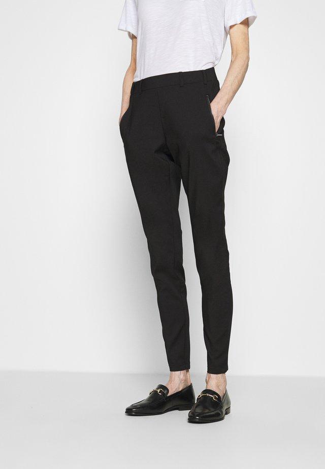 VERA LIVA - Pantalones - black deep