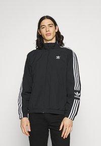 adidas Originals - LOCK UNISEX - Tunn jacka - black - 0
