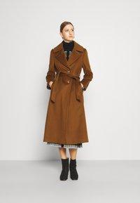 Sand Copenhagen - COAT CLARETA BELT - Classic coat - brown - 0