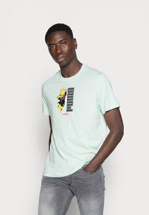 PUMA HARIBO GRAPHIC TEE - Print T-shirt - gossamer green