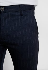 Gabba - PISA PINSTRIPE CROP - Trousers - navy stripe - 5
