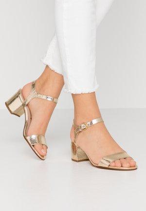 ABRIGA - Sandals - gold