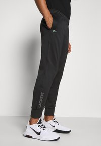 Lacoste Sport - TENNIS PANT - Tracksuit bottoms - black - 4