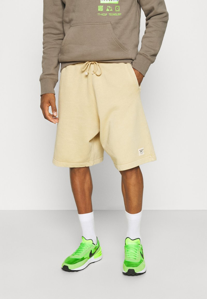 Reebok Classic - CLASSIC NATURAL DYE - Tracksuit bottoms - sepia