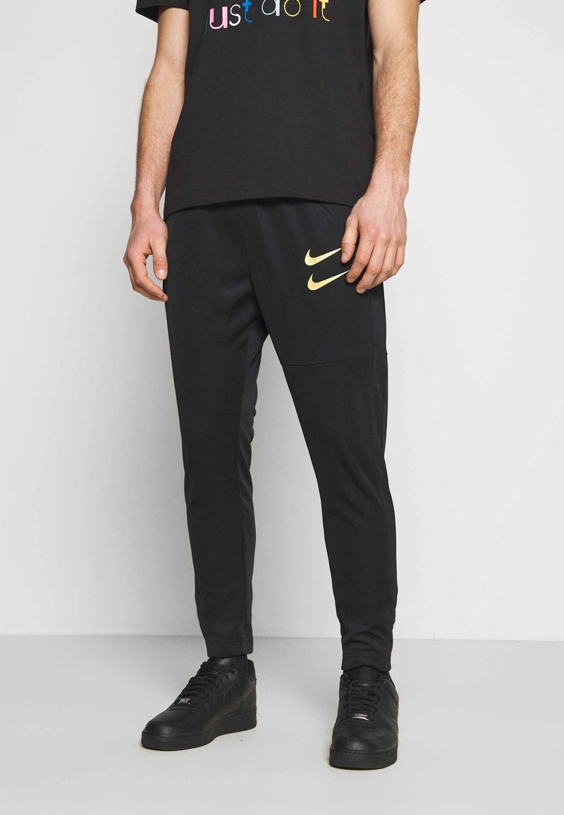 Nike Sportswear - PANT - Tracksuit bottoms - black/gold