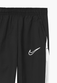 Nike Performance - DRY ACADEMY  - Tracksuit bottoms - black/white - 2