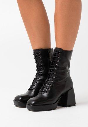 NOELIA - High heeled ankle boots - black