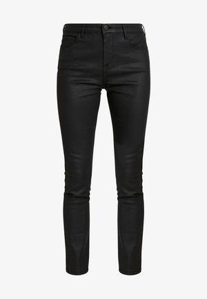 CADOU COATED - Pantalones - black