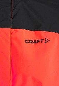 Craft - CORE ENDUR HYDRO JACKET  - Veste coupe-vent - coralle - 2