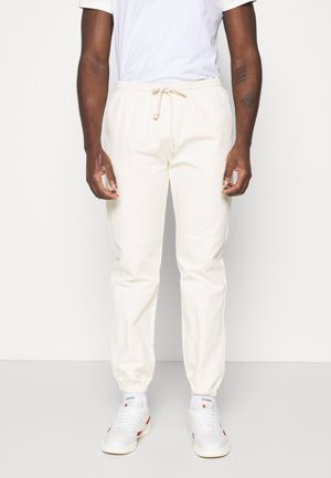 BASIC PANTS - Tracksuit bottoms - beige