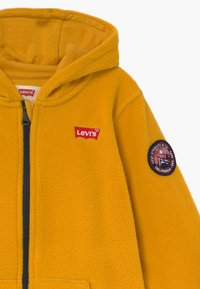 Levi's® - LOGO PATCH FULL ZIP - Fleecejas - golden yellow - 4