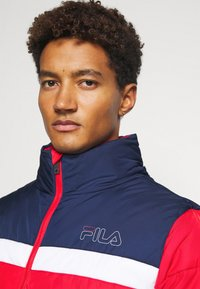 Fila - LANDOLF PUFFED JACKET - Träningsjacka - true red/black iris/bright white - 3