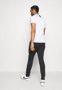 Nike Performance - DRY STRIKE WINTERIZED - Teplákové kalhoty - black/volt - 2