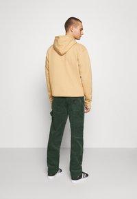 Karl Kani - PANTS - Trousers - green - 2
