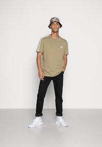 adidas Originals - TECH TEE - Print T-shirt - orbit green - 1