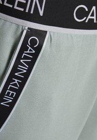 Calvin Klein Performance - PANTS - Teplákové kalhoty - green - 5