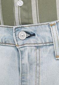 Levi's® - 412™ SLIM - Denim shorts - light blue denim - 4