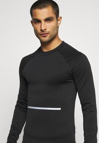 NU-IN - COMPRESSION LONG SLEEVE - Long sleeved top - black - 4