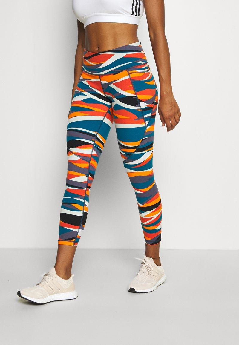 Sweaty Betty - POWER 7/8 WORKOUT LEGGINGS - Tights - orange hills print