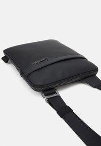 Calvin Klein - FLATPACK - Across body bag - black - 3