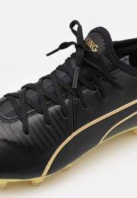 Puma - KING PRO FG - Moulded stud football boots - black/team gold - 5