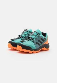 adidas Performance - TERREX GTX UNISEX - Hiking shoes - acid mint/core black/screaming orange - 1