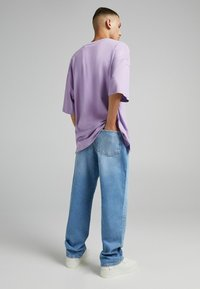 Bershka - TAPERED - Relaxed fit jeans - blue denim - 2