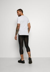 Nike Performance - Leggings - black - 2
