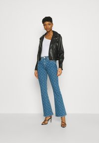 River Island - Flared jeans - mid auth - 1