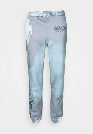SLOGAN TIE DYE JOGGERS UNISEX - Spodnie treningowe - mint
