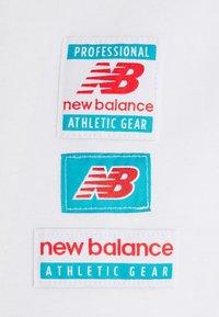 New Balance - ESSENTIALS TAG TEE - Basic T-shirt - white - 2