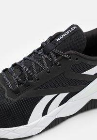 Reebok - NANOFLEX TR - Sports shoes - core black/footwear white - 5