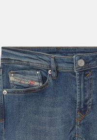Diesel - WAYKEE UNISEX - Straight leg jeans - blue denim - 2