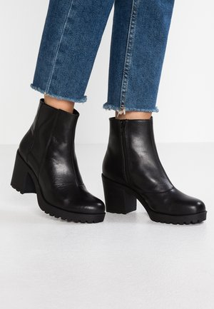GRACE - Platform ankle boots - black